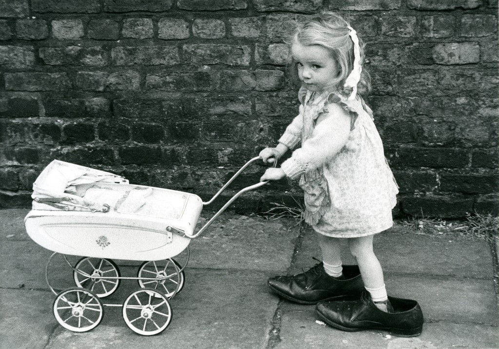 Girl with Pram by Shirley Baker