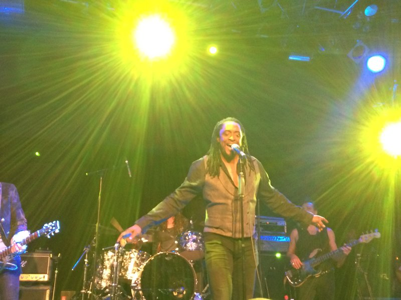 Bernard Fowler sings on stage