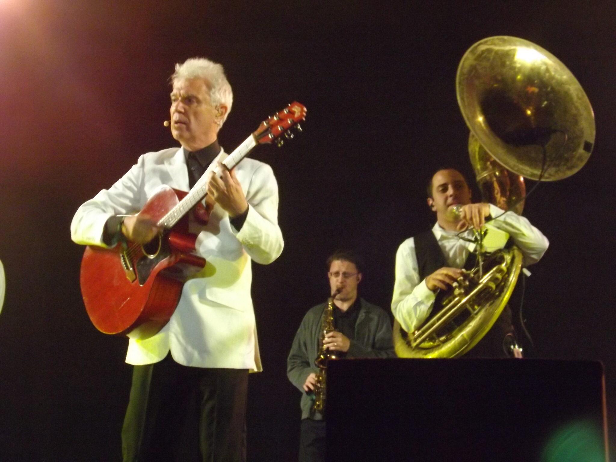 David Byrne sings on stage