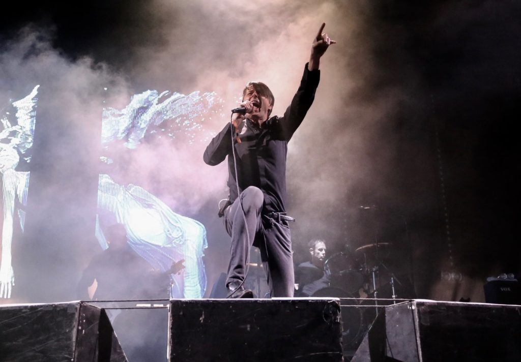 Brett Anderson of Suede sings on stage